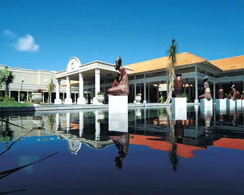 An exterior view of Club Melia At Gran Melia Puerto Rico resort alongside the waterfront.