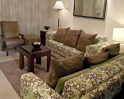 A well furnished living room with two double pull out sofas.