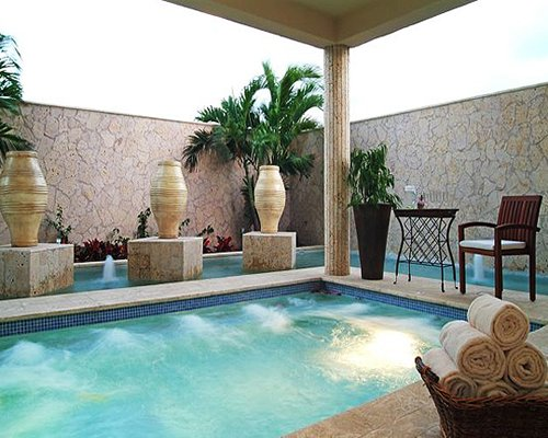 An indoor well furnished swimming pool.