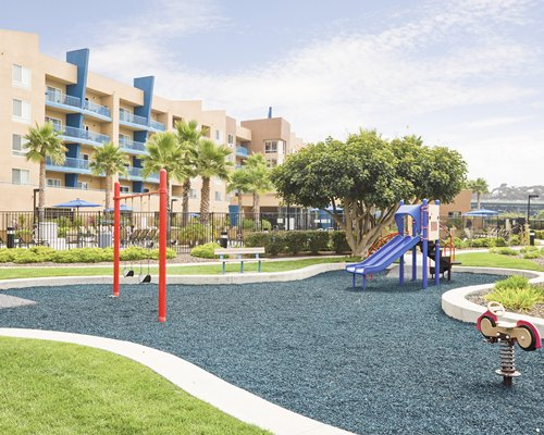 An outdoor playscape alongside the resort unit.