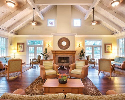 Lounge area with fireplace and vaulted ceiling.