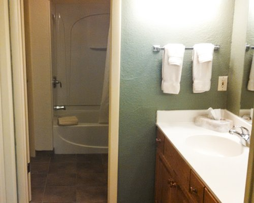 A bathroom with shower bathtub and closed sink vanity.