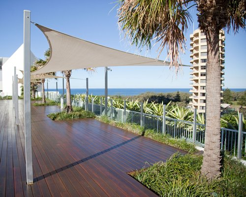 Exterior view of a deck alongside the ocean.