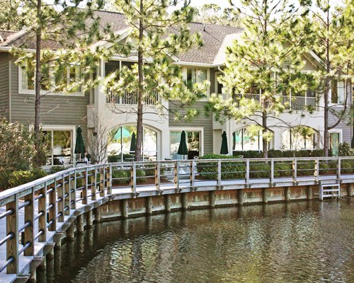 A pathway on the water leading to resort units.