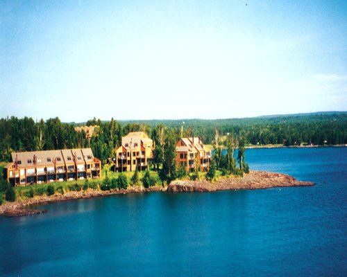 Exterior view of Lakehomes at Superior Shores surrounded by wooded area alongside the ocean.