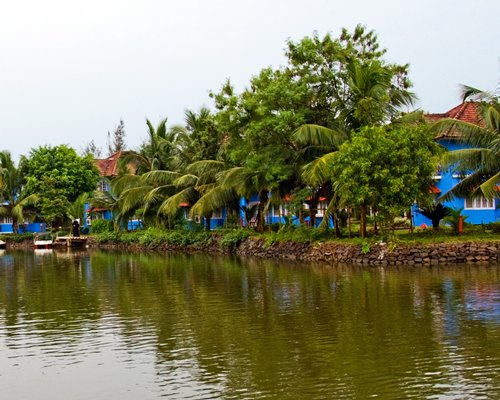 View of Kairali Heritage alongside the water surrounded by wooded area.