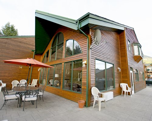 Exterior view of a unit with outdoor dining and sunshade.