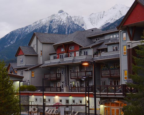 Scenic exterior view of Elkhorn at the Lodges with multiple balconies alongside the mountains during winter.