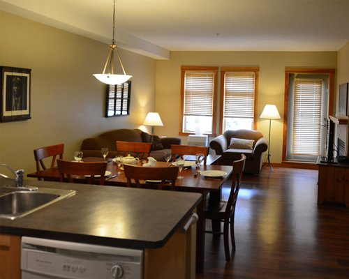 An open plan living room with a dining and kitchen area.
