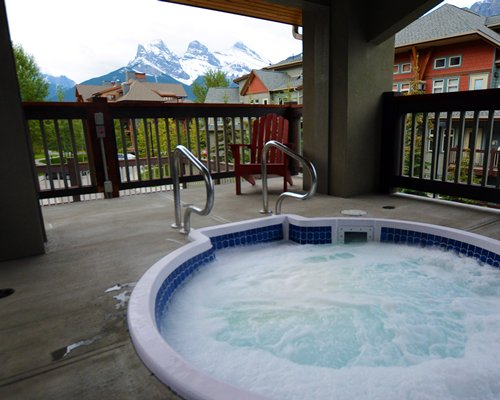A balcony with hot tub.