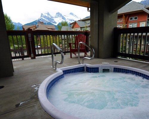 A balcony with hot tub.