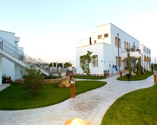 Exterior view of the pathway leading to the units at Residence Portoselvaggio.