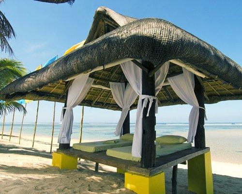 An outdoor spa area alongside the beach.