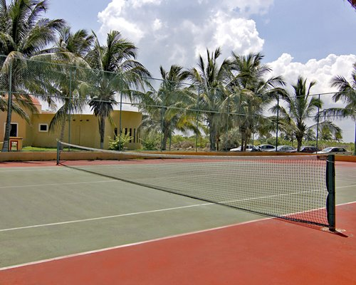 An outdoor paddle tennis court alongside the resort unit.