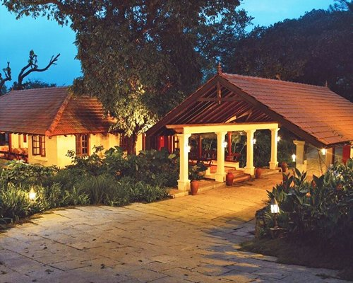 Exterior view of Club Mahindra Madikeri Coorg at night.