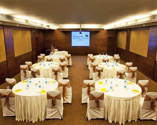 An indoor conference room with dining setup.