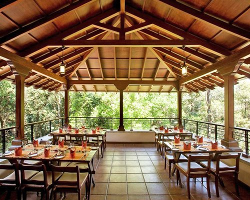 An indoor fine dining area at the resort with an outside view.