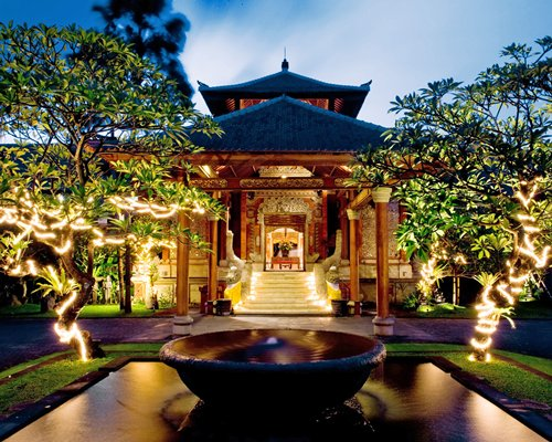 Scenic exterior view of Keraton Jimbaran Resort at night.