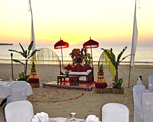Decorated wedding venue alongside the beach.