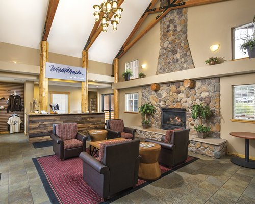 Reception lobby of the WorldMark Estes Park with fire in the fireplace.