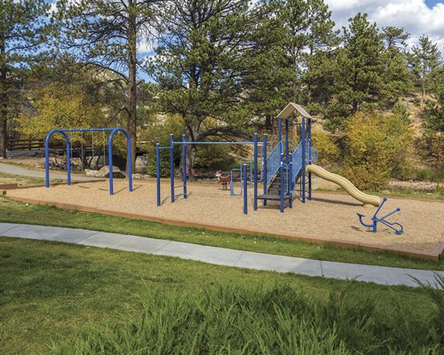 Scenic outdoor picnic area with kids playscape.