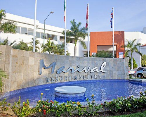 Outdoor pool alongside Marival Resort & Suites.