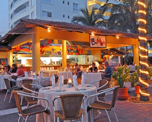 An outdoor restaurant at Marival Resort & Suites.