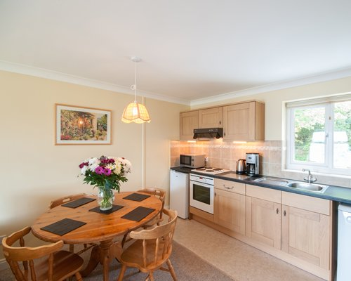 An open plan dining and kitchen area with a microwave oven.