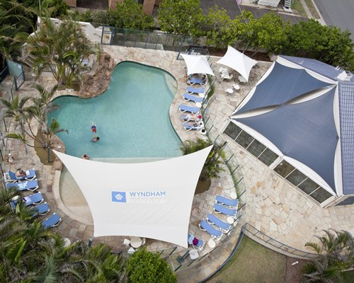 An aerial view of the outdoor swimming pool with chaise lounge chairs.