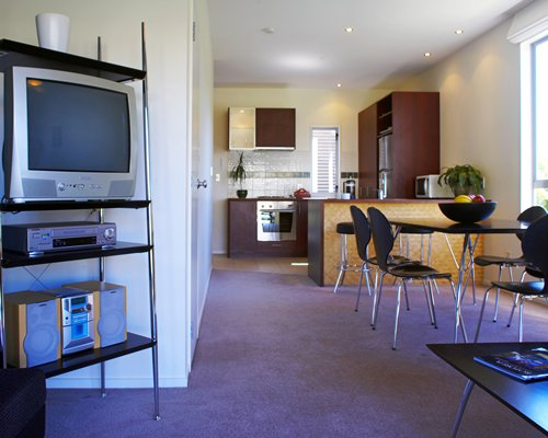 An open plan dining and kitchen area with a television.