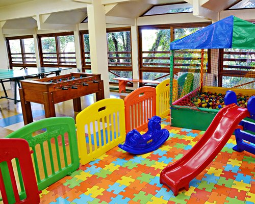 An indoor recreational area with kids playscape.