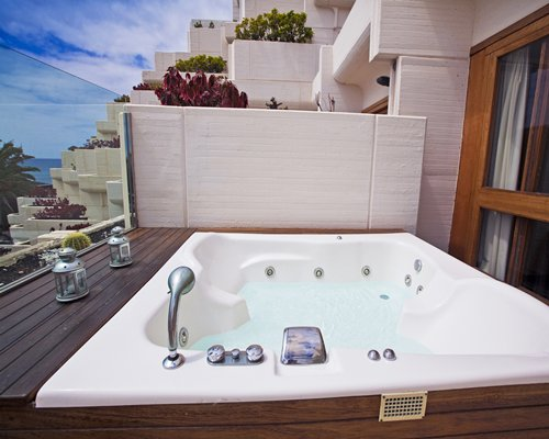 Outdoor hot tub on a balcony.