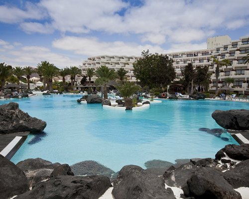 Club Melia at Gran Melia Salinas with large outdoor swimming pool surrounded by rocks and landscaping.