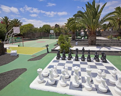 Outdoor recreation area with a giant chess and basketball court.