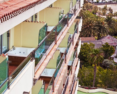 View of multiple balconies at Club Melia at Melia Tamarindos.