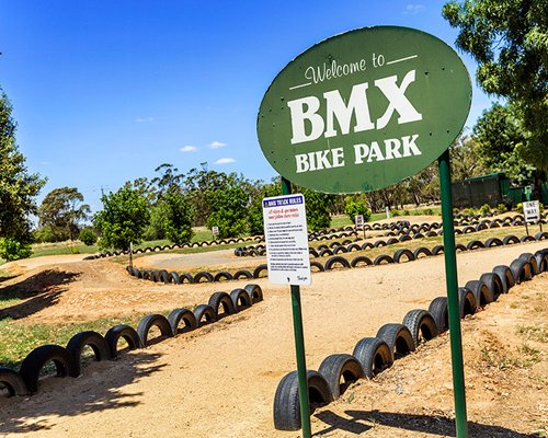 Signboard of BMX Bike Park with a pathway.