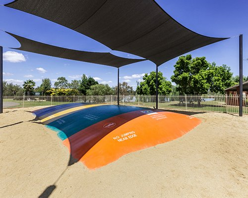 Outdoor recreation area with sunshades.