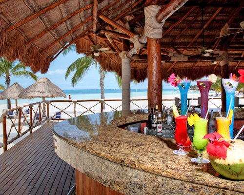 A view of the poolside bar alongside the ocean.