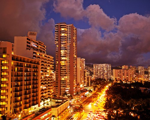 An aerial view of Grand Waikikian by Hilton Grand Vacations Club resort at night.