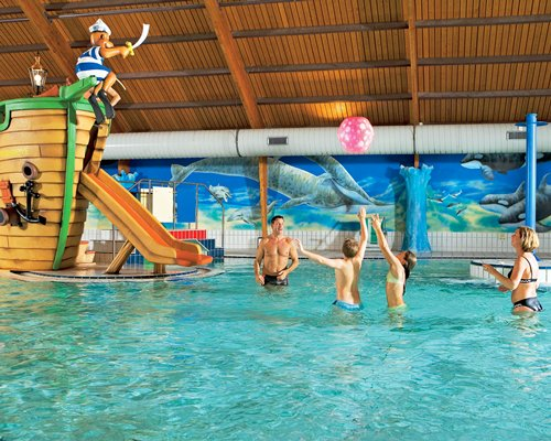 A family playing in the indoor water park.