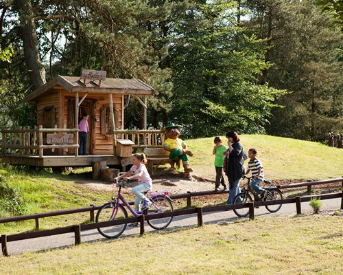 View of kids riding bikes alongside a unit at Landal Coldenhove.