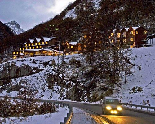 An exterior view of Australis Kauyeken (Rental) resort covered in snow.