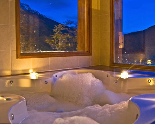 A bathtub with an outside view.