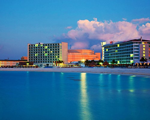 Exterior view of Krystal International Vacation Club Cancun from the waterfront.