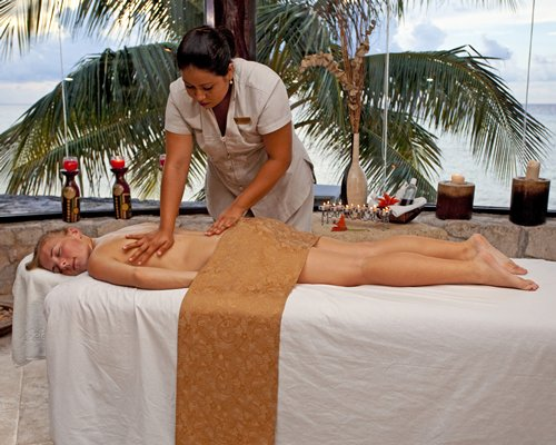 A woman enjoying a massage in an outdoor spa.