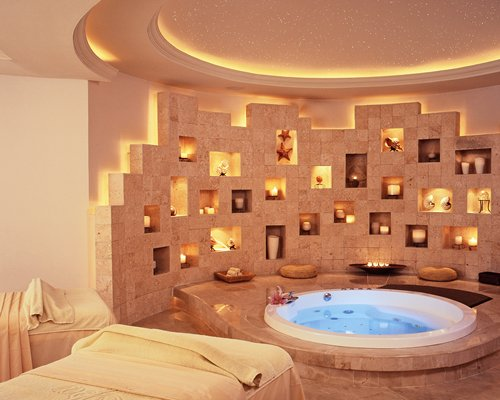 An indoor spa area with hot tub.
