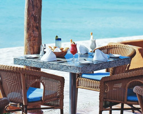 An outdoor dining area alongside the ocean.
