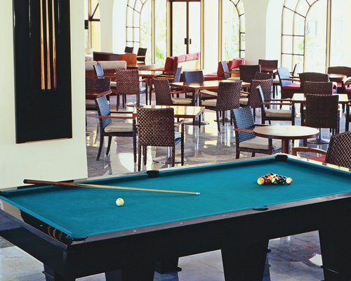 A large indoor recreation room with pool table.
