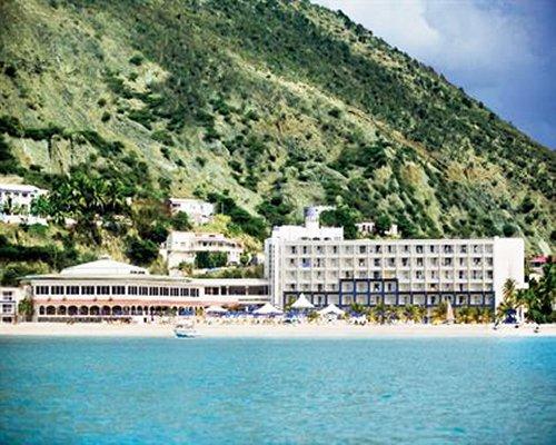 Exterior view of Sonesta Great Bay Beach Resort alongside the beach.