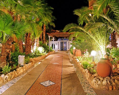Scenic pathway leading to Ona Aldea Del Mar resort at night.